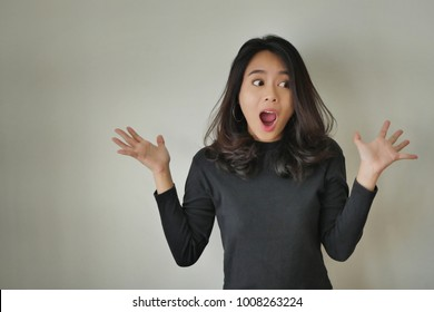 portrait of excited girl, surprised woman with wow oh uh ah face expression; excited woman, happy woman, surprised girl, amazed girl portrait; joyful cheerful person asian girl young adult woman model