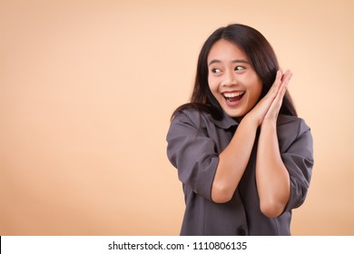 portrait of excited happy smiling asian business woman; happy smiling successful excited surprised business woman looking up; asian 20s young adult woman model