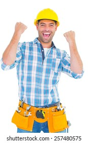 Portrait of excited manual worker clenching fists on white background