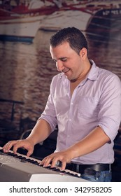 Portrait of excited musician playing synthesizer