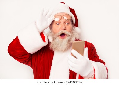 Portrait of excited Santa looking on clock on smartphone and understanding that he is late