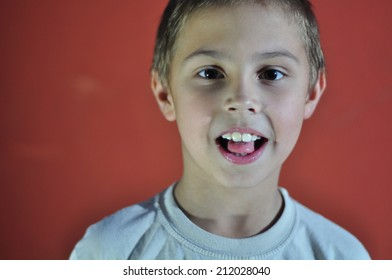 Portrait of excited small boy. Hard light.