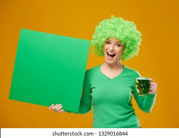 Portrait of excited woman with beer mug and blank banner