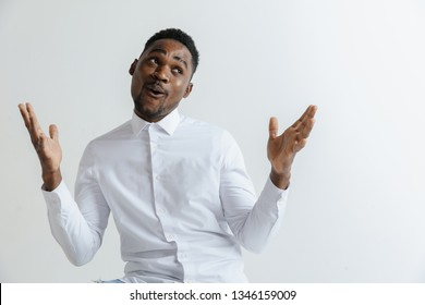 Portrait of excited young African American male screaming in shock and amazement. Surprised black hipster looking impressed, can't believe his own luck and success