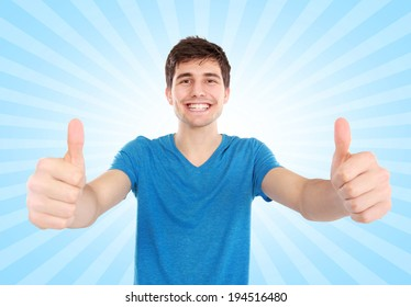 portrait of excited Young male student showing two thumbs