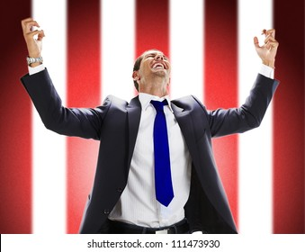 Portrait of an excited young man celebrating his success
