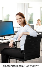 Portrait of executive business woman and businessman working on laptop at office. Business people.