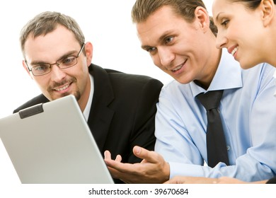 Portrait of executive specialists working with laptop