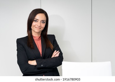 portrait of executive woman in office with white background cabinets