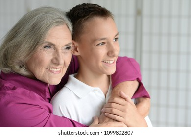 Portrait of exited grandmother and grandson