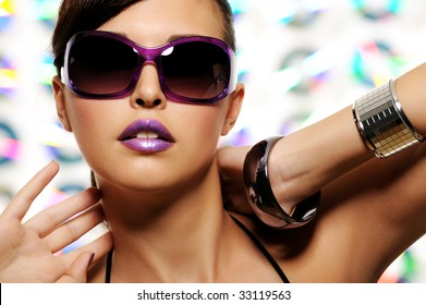 portrait of expressive beautiful young woman with stylish sunglasses