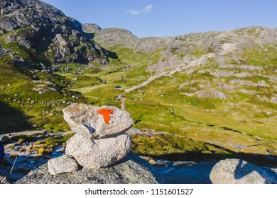 Portrait of a extreme plan travel for the girl on the stone of the kjerag in the mountains kjeragbolten of Norway, the feeling of complete freedom