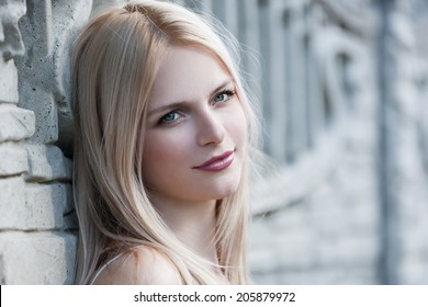portrait  face beautiful blonde woman  with blue eyes