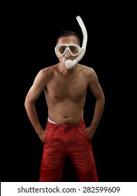portrait face of young asian man wearing snorkel mask standing against black background with studio lighting