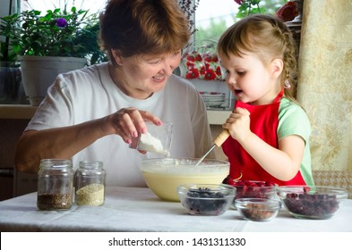 Portrait of faces, hands happy granny, granddaughter. toddler girl play with baking, dough, flour on kitchen. child baby try study cooking cookies, cake. Cozy family Look at each other