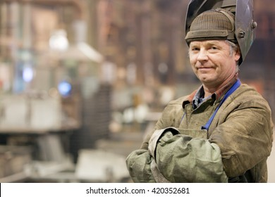 Portrait factory senior welder worker on manufacture workshop background