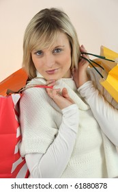 Portrait of a fair-haired woman with shopping bags
