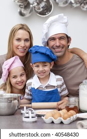 Portrait of family baking cookies in the kitchen