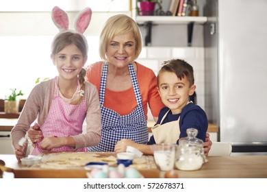 Portrait of family baking in kitchen interior