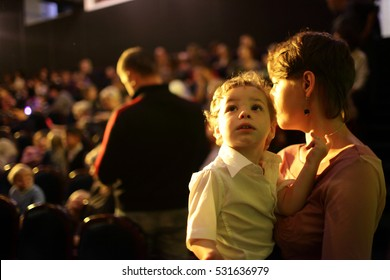 Portrait of family at a concert in the evening