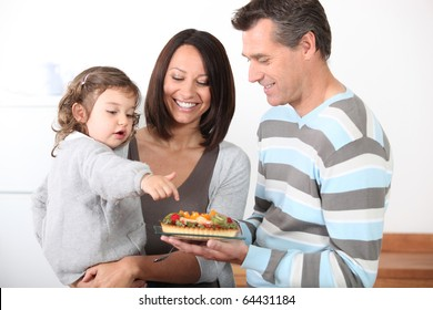Portrait of family eating a fruit pie