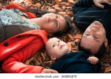 Portrait of family enjoying a day in the woods during fall.