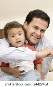 Portrait of family, father playing with his son