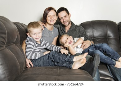 A Portrait of family having fun in the living room. Happy family spending time at home together.