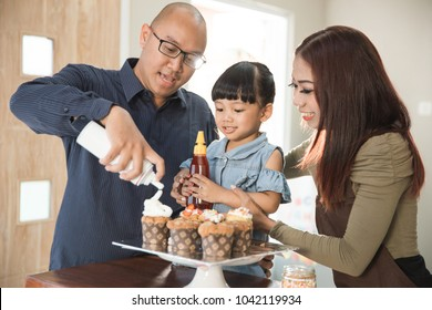 Portrait of family member spending their time together cooking in the kitchen