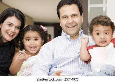 Portrait of family, mom and dad playing with their children at home, mom and dad playing with their children at home
