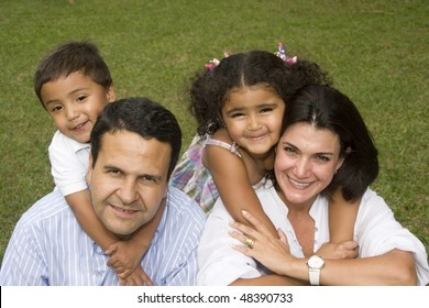 Portrait of family, mom and dad walking with their children at home