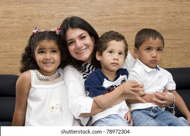 Portrait of Family, Mother Playing With His Children At Home