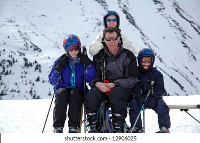 portrait of family in the mountains on a ski holiday
