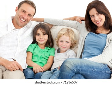 Portrait of a family on the sofa while watching television