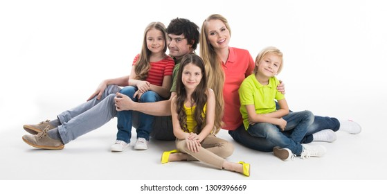 Portrait of family of parents and three children studio isolated on white background