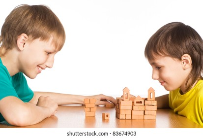 portrait of a family playing at table