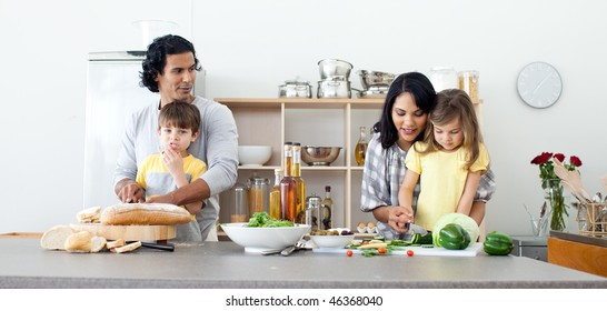 Portrait of a family preparing lunch in the kitchen