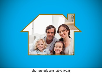 Portrait of a family relaxing in their living room against blue background with vignette