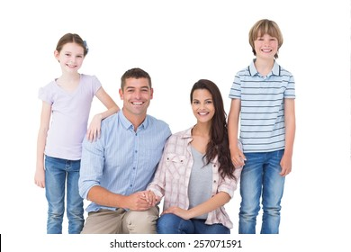 Portrait of family smiling together over white background