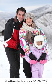 Portrait of a family at the snow