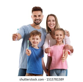 Portrait of family with toothbrushes on white background