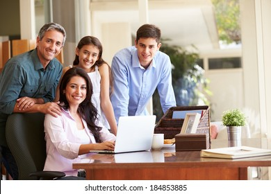 Portrait Of Family Using Laptop Together