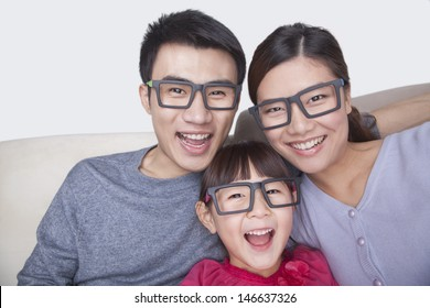 Portrait of Family wearing black glasses, studio shot