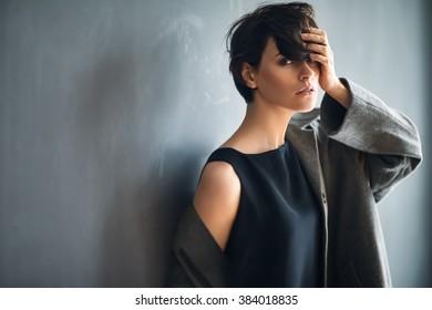 Portrait of fashion beautiful woman on dark background
