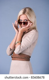 portrait of fashion blond woman in dress with sunglasses