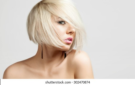 Portrait of a fashion blonde with short hair and bare shoulders