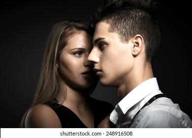 Portrait of fashion couple against grey background