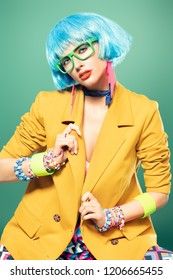 Portrait of a fashion girl with blue hair wearing bright summer clothes over blue background. Beauty, fashion concept.  Pin-up style.