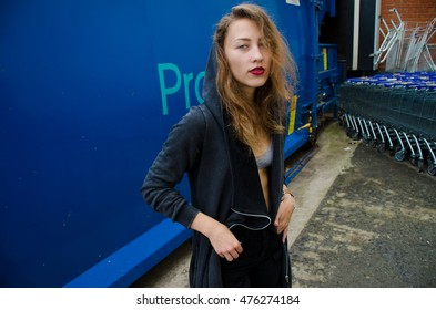 portrait of a fashion girl of natural beauty in urban background