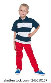 A portrait of a fashion little boy in the red pants on the white background